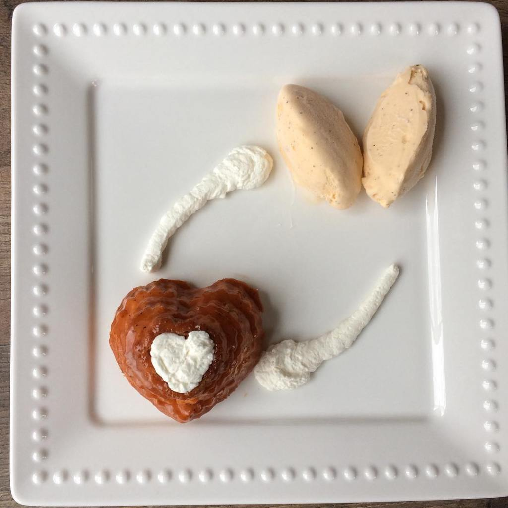 Photo of heart-shaped dessert on a square, white plate